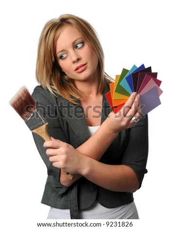 Gorgeous woman with paint brush and color swatches over a white background