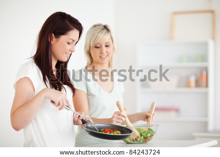 Gorgeous Women cooking dinner in a kitchen