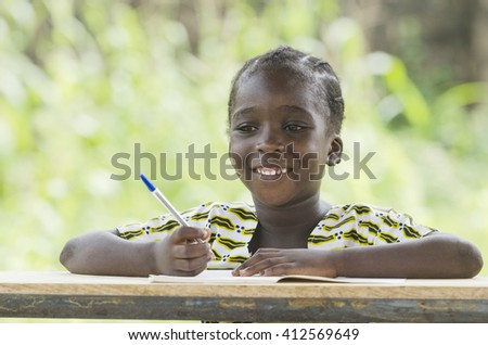Gorgeous Young African Schoolgirl Laughing at School - stock photo