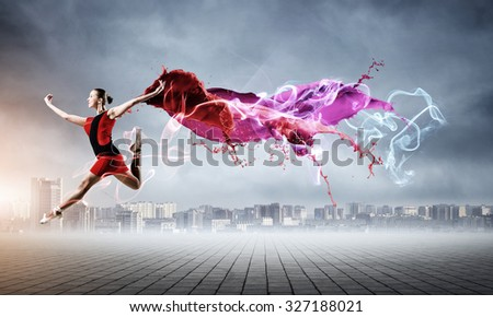 Gorgeous young ballet dancer wearing red dress over modern city background - stock photo