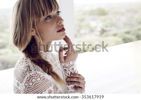 Gorgeous young blond woman looking away, close up