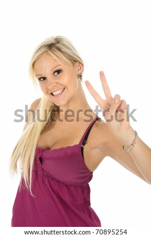 Gorgeous young blonde lady showing the peace sign - stock photo