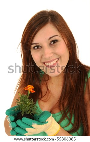 Gorgeous young brunette lady with seedling in her gloved hands