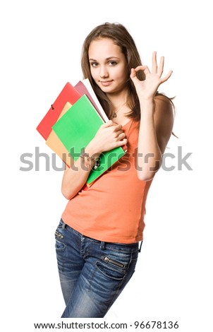 Gorgeous young brunette student girl showing o.k. isolated on white background. - stock photo
