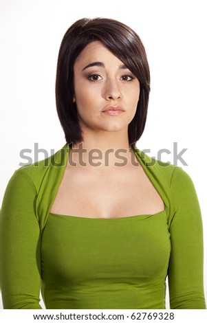 Gorgeous young brunette with a shy expression. - stock photo