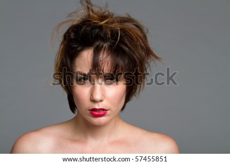 Gorgeous young brunette woman with short messy hair and red lips - stock photo