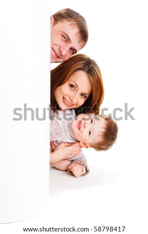 Gorgeous young family, peeping out - stock photo