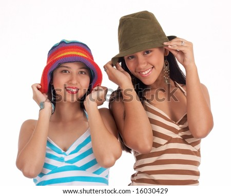 Gorgeous young girls wearing hat - green and rainbow color - stock photo