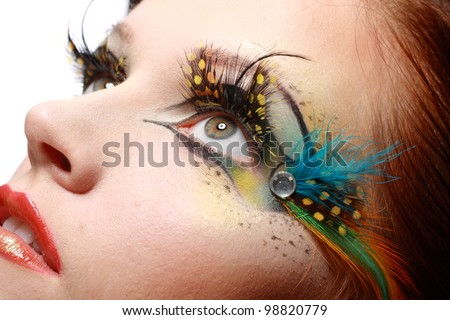 Gorgeous Young model beautiful women with perfect art make up and long false eyelashes made from feathers - stock photo