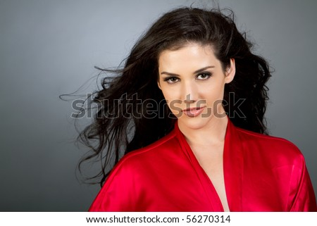 Gorgeous young multiracial woman with dark hair fashion shot