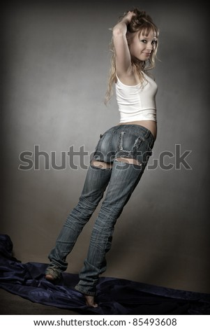 Gorgeous young sexy blond girl posing in studio - stock photo