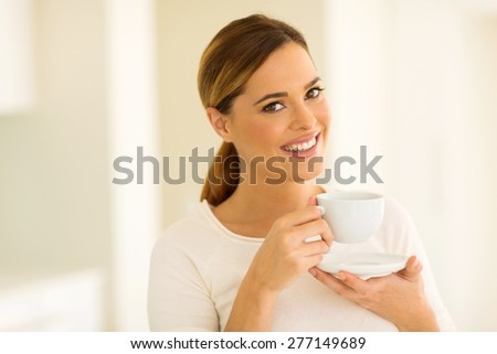 gorgeous young woman drinking tea at home