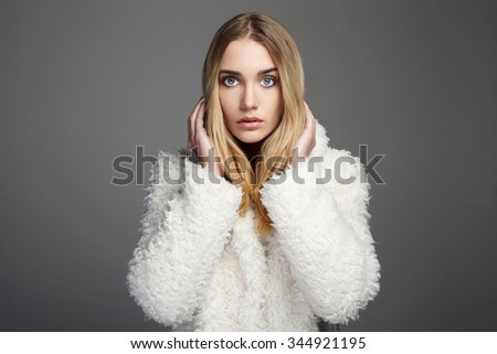 Gorgeous young woman in winter fashion wearing a fur.beautiful blond hair model girl - stock photo