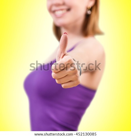 Gorgeous young woman showing big thumbs up - stock photo