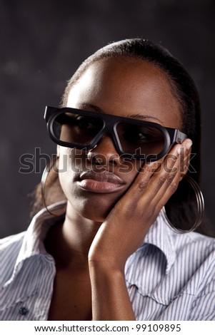Gorgeous young woman watching a 3D movie, with 3D glasses on.