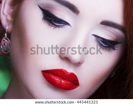 Gorgeous young woman with long eyelashes. Perfect makeup.