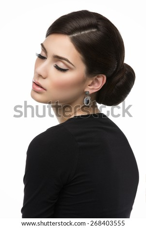 Gorgeous young woman with natural beautiful makeup and elegant hairstyle isolated over white background - stock photo