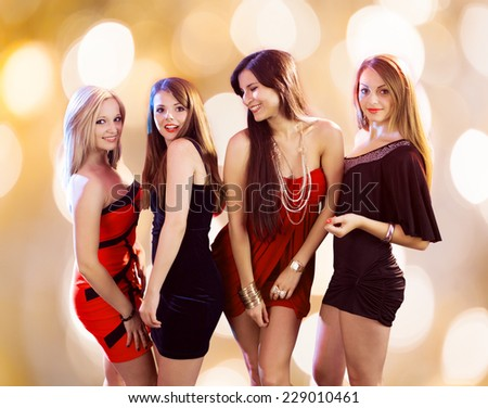 Gorgeous young women dancing together at nightclub - stock photo