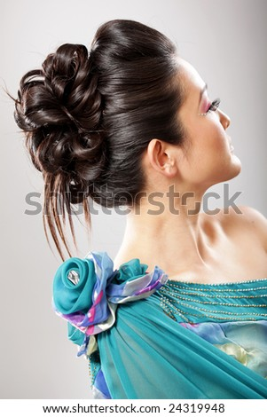 Gorgeously created elegant updo on a brunette model - stock photo