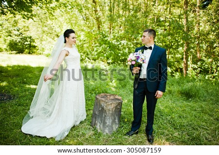 Gorgeus wedding couple on green sunny forest