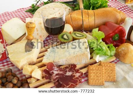 Gorgonzola, parmigiano, pecorino cheese, with wine and bread, typical Italian food, Piacenza - stock photo