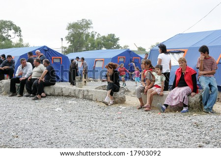 GORI, GEORGIA - SEPTEMBER 8: Refugees  from the Georgia's breakaway South Ossetia region and the bomb-damaged town of Gori sit outside tents at a refugee camp on September 8, 2008 in Gori, Georgia.