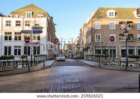 Gorinchem, Netherlands - January 17, 2015: People and cars in the Dutch town Gorinchem. - stock photo
