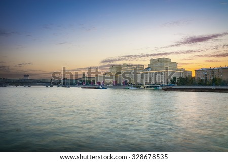 Gorky Park. Moscow River, complex of buildings of the Ministry of Defense and Andreevskiy Bridge in the evening. - stock photo