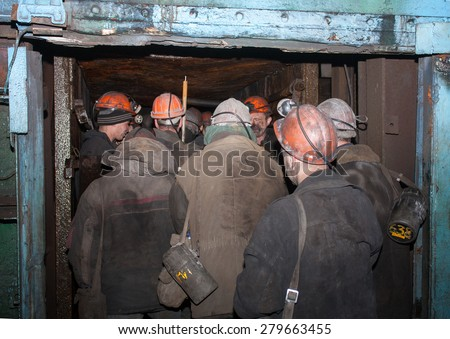 Gorlovka, Ukraine - February, 26, 2014: Miners of the mine named after Kalinin down in underground mines - stock photo