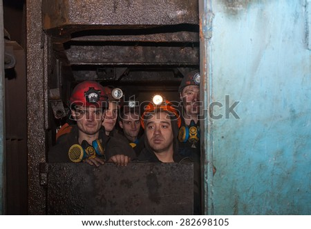 Gorlovka, Ukraine - February 26, 2014: The miners of the mine named after Kalinin fall into the workplace in underground mines - stock photo