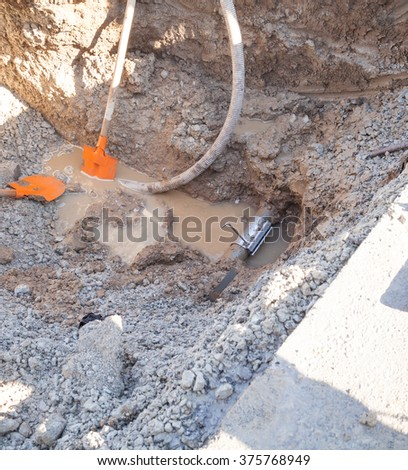 Gorna Oryahovitsa - November 5: Repair of urban water and sewerage - stages. The clamp is placed on the puncture site on November 5, 2015, Gorna Oryahovitsa, Bulgaria - stock photo