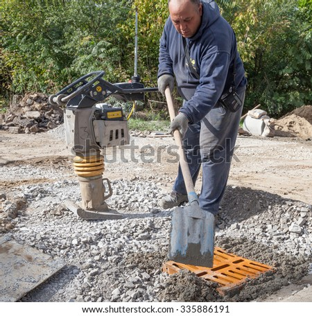 Gorna Oryahovitsa -October 17: Construction Site-Repair Plumbing and construction of additional drainage manholes. A worker prepares the shaft of  October 17, 2015, Gorna Oryahovitsa, Bulgaria