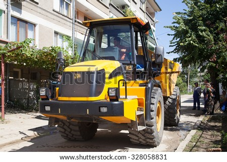 Gorna Oryahovitsa - September 14: Repair of street water installation with heavy machinery and hand-urban arm of the September 14, 2015, Gorna Oryahovitsa,