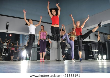 gorup of girls in fitness studio jumping in air - stock photo