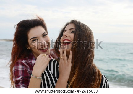 gossip girls smiling on the beach