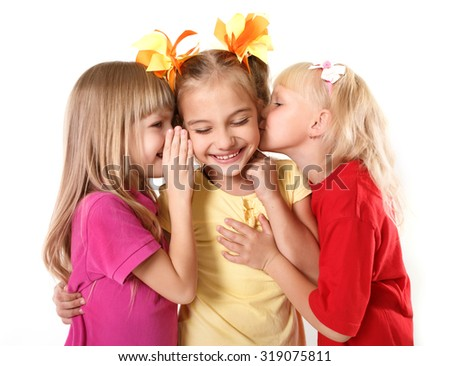 Gossip.Kids girlfriends sharing a secret isolated - stock photo