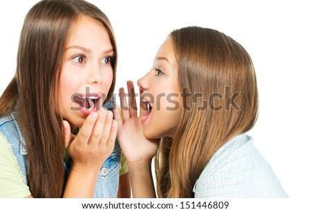 Gossip. Two Teenage Girls Speaking and Sharing Secrets. Whispering Girlfriends  - stock photo