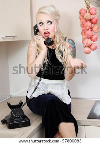 Gossiping housewife - stock photo
