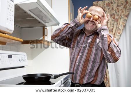 Got eggs - Man frying eggs - stock photo
