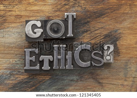 Got ethics question in vintage letterpress metal type on a grunge painted wood background - stock photo