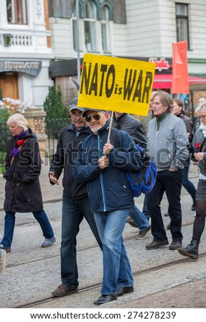 Goteborg, Sweden - May 01 , 2015: Man with a anti NATO message during a manifestation at the International Workers' Day in Goteborg, Sweden.