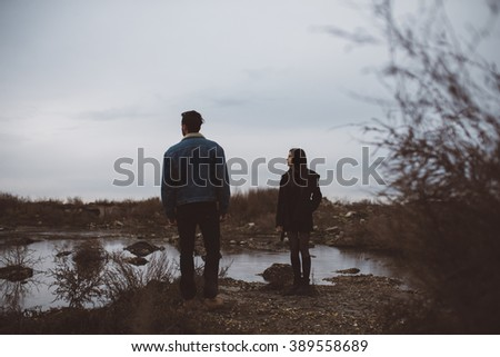 Goth couple outdoors love story - stock photo