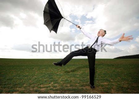 goth guy in business clothes fights with his umbrella