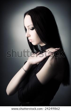 Goth woman portrait. Soft colors. - stock photo
