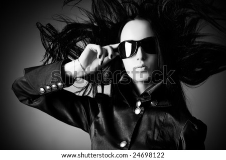 Goth woman with fluttering hair. Black and white concept. - stock photo