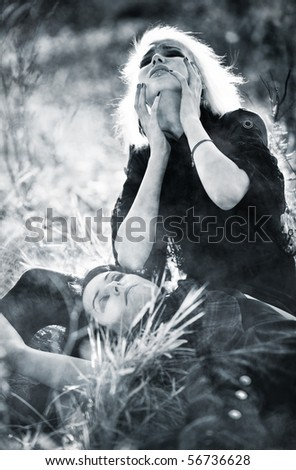 Goth women sorrow concept. Contrast colors. - stock photo