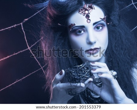 Goth. Young woman in creative image.