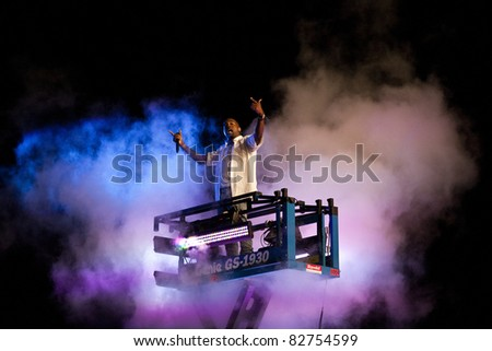 GOTHENBURG, SWEDEN - AUGUST 13: Kanye West performs at the Way Out West festival on August 13, 2011 in Gothenburg, Sweden. West rose from a cloud of smoke in the crowd for the first song of the night - stock photo