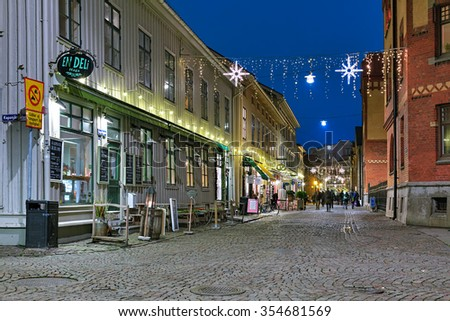 GOTHENBURG, SWEDEN - DECEMBER 16, 2015: Haga Nygata street with Christmas illuminations. The pedestrian street Haga Nygata is lined with well-preserved wooden houses of 19th century. - stock photo