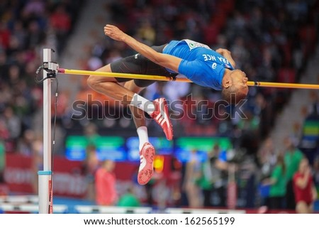 GOTHENBURG, SWEDEN - MARCH 1 Mickael Hanany (FRA) competes in the qualification of the men's high jump event during the European Athletics Indoor Championship on March 1, 2013 in Gothenburg, Sweden. - stock photo